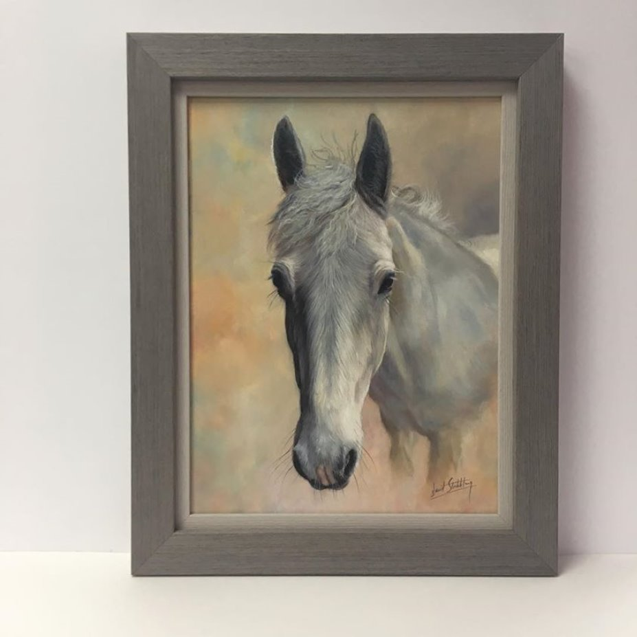 framed oil of a horse